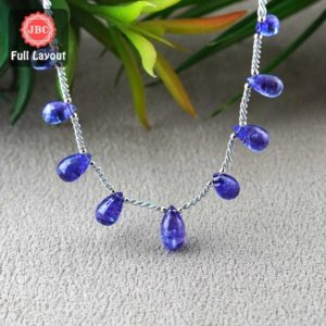 Shop Tanzanite Bead Shapes! Natural Tanzanite 9-13.5mm Smooth Drops Shape Gemstone Beads / Approx. 9 Pieces On 8 Inch Long Layout / Jbc-et-156786 | Natural genuine other-shape Tanzanite beads for beading and jewelry making.  #jewelry #beads #beadedjewelry #diyjewelry #jewelrymaking #beadstore #beading #affiliate #ad