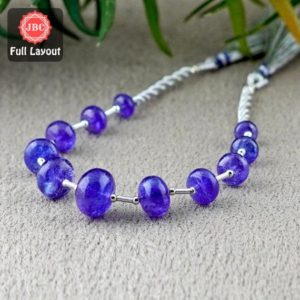 Shop Tanzanite Rondelle Beads! Natural Tanzanite 6.5-13mm Smooth Rondelle Shape Gemstone Beads / Approx. 11 Pieces on 8 Inch Long Layout / JBC-ET-156716 | Natural genuine rondelle Tanzanite beads for beading and jewelry making.  #jewelry #beads #beadedjewelry #diyjewelry #jewelrymaking #beadstore #beading #affiliate #ad