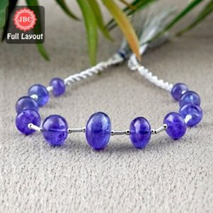 Shop Tanzanite Rondelle Beads! Natural Tanzanite 7-14mm Smooth Rondelle Shape Gemstone Beads / Approx. 11 Pieces on 8 Inch Long Layout / JBC-ET-156708 | Natural genuine rondelle Tanzanite beads for beading and jewelry making.  #jewelry #beads #beadedjewelry #diyjewelry #jewelrymaking #beadstore #beading #affiliate #ad