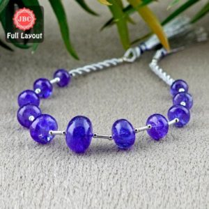 Shop Tanzanite Rondelle Beads! Natural Tanzanite 7.5-14.5mm Smooth Rondelle Shape Gemstone Beads / Approx. 11 Pieces on 8 Inch Long Layout / JBC-ET-156714 | Natural genuine rondelle Tanzanite beads for beading and jewelry making.  #jewelry #beads #beadedjewelry #diyjewelry #jewelrymaking #beadstore #beading #affiliate #ad