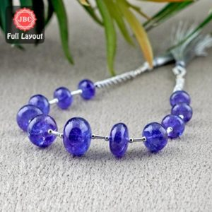 Shop Tanzanite Rondelle Beads! Natural Tanzanite 8.5-15.5mm Smooth Rondelle Shape Gemstone Beads / Approx. 11 Pieces on 8 Inch Long Layout / JBC-ET-156705 | Natural genuine rondelle Tanzanite beads for beading and jewelry making.  #jewelry #beads #beadedjewelry #diyjewelry #jewelrymaking #beadstore #beading #affiliate #ad