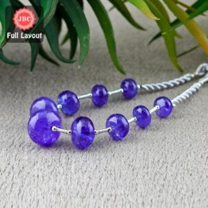 Shop Tanzanite Rondelle Beads! Natural Tanzanite 8.5-15mm Smooth Rondelle Shape Gemstone Beads / Approx. 9 Pieces on 7 Inch Long Layout / JBC-ET-156713 | Natural genuine rondelle Tanzanite beads for beading and jewelry making.  #jewelry #beads #beadedjewelry #diyjewelry #jewelrymaking #beadstore #beading #affiliate #ad