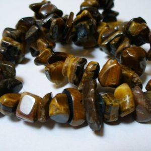 Shop Tiger Eye Chip & Nugget Beads! Tiger Eye Medium Chips Gemstone 8mm – 20mm | Natural genuine chip Tiger Eye beads for beading and jewelry making.  #jewelry #beads #beadedjewelry #diyjewelry #jewelrymaking #beadstore #beading #affiliate #ad