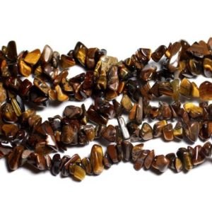 Shop Tiger Eye Chip & Nugget Beads! Wire 89cm 300pc env – stone beads – rock Chips 5-10mm Tiger eye | Natural genuine chip Tiger Eye beads for beading and jewelry making.  #jewelry #beads #beadedjewelry #diyjewelry #jewelrymaking #beadstore #beading #affiliate #ad