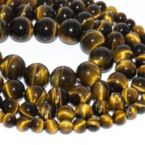 Shop Tiger Eye Beads! Genuine Natural Yellow Tiger Eye Loose Beads Grade AAA Round Shape 6mm 8mm 10mm 12mm | Natural genuine beads Tiger Eye beads for beading and jewelry making.  #jewelry #beads #beadedjewelry #diyjewelry #jewelrymaking #beadstore #beading #affiliate #ad
