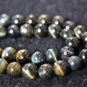 Shop Tiger Eye Round Beads! Natural Blue Tigereye Beads,6mm/8mm/10mm/12mm Smooth and Round Stone Beads,15 inches one starand | Natural genuine round Tiger Eye beads for beading and jewelry making.  #jewelry #beads #beadedjewelry #diyjewelry #jewelrymaking #beadstore #beading #affiliate #ad