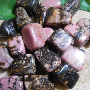 Shop Tumbled Rhodonite Crystals & Pocket Stones! Rhodonite, Rhodonite Crystal, Pink Crystal, Tumbled Crystals, Black Crystal, Healing Stone, Feng Shui, Heart Chakra, Chakra Crystal | Natural genuine stones & crystals in various shapes & sizes. Buy raw cut, tumbled, or polished gemstones for making jewelry or crystal healing energy vibration raising reiki stones. #crystals #gemstones #crystalhealing #crystalsandgemstones #energyhealing #affiliate #ad