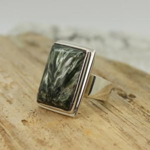 Shop Seraphinite Rings! Unique piece… Seraphinite ring big rectangle shape green Seraphinite cab stone set on 925 sterling silver solid quality work handmade   Natural genuine Seraphinite rings, simple unique handcrafted gemstone rings. #rings #jewelry #shopping #gift #handmade #fashion #style #affiliate #ad