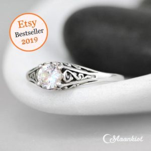 Shop Healing Gemstone Rings! Dainty White Sapphire Engagement Ring, Sterling Silver Filigree Engagement Ring, Alternative Engagement Ring, Vintage Style Promise Ring | Natural genuine Gemstone rings, simple unique alternative gemstone engagement rings. #rings #jewelry #bridal #wedding #jewelryaccessories #engagementrings #weddingideas #affiliate #ad
