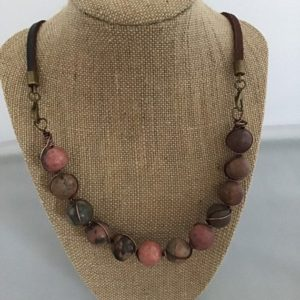 Shop Rhodonite Necklaces! Wire wrapped 10 mm rhodonite bead necklace. Leather strap. | Natural genuine Rhodonite necklaces. Buy crystal jewelry, handmade handcrafted artisan jewelry for women.  Unique handmade gift ideas. #jewelry #beadednecklaces #beadedjewelry #gift #shopping #handmadejewelry #fashion #style #product #necklaces #affiliate #ad