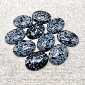 40mm, snowflake obsidian, cabochons | Natural genuine stones & crystals in various shapes & sizes. Buy raw cut, tumbled, or polished gemstones for making jewelry or crystal healing energy vibration raising reiki stones. #crystals #gemstones #crystalhealing #crystalsandgemstones #energyhealing #affiliate #ad