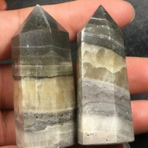 Shop Onyx Points & Wands! 100g 2 pc Natural Jade Carved Point Wand Stick | Natural genuine stones & crystals in various shapes & sizes. Buy raw cut, tumbled, or polished gemstones for making jewelry or crystal healing energy vibration raising reiki stones. #crystals #gemstones #crystalhealing #crystalsandgemstones #energyhealing #affiliate #ad
