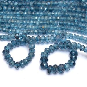 Shop Topaz Beads! AAA+ London Blue Topaz 4mm-5mm Faceted Rondelle Beads | Natural Blue Topaz Semi Precious Gemstone Beads | Genuine Fine Topaz Rondelle Beads | Natural genuine beads Topaz beads for beading and jewelry making.  #jewelry #beads #beadedjewelry #diyjewelry #jewelrymaking #beadstore #beading #affiliate #ad