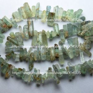 Shop Aquamarine Points & Wands! 7 Inches Strand, natural Aquamarine Stick.8-16mm | Natural genuine stones & crystals in various shapes & sizes. Buy raw cut, tumbled, or polished gemstones for making jewelry or crystal healing energy vibration raising reiki stones. #crystals #gemstones #crystalhealing #crystalsandgemstones #energyhealing #affiliate #ad