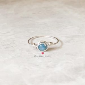 Shop Angelite Rings! Blue angelite ring, handmade sterling silver wire wrapped jewelry for her, stacking healing crystal gemstone ring for women | Natural genuine Angelite rings, simple unique handcrafted gemstone rings. #rings #jewelry #shopping #gift #handmade #fashion #style #affiliate #ad