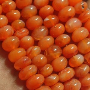 Shop Carnelian Rondelle Beads! Beautiful Natural Carnelian Smooth Rondelle Shape Beads Strand | Carnelian Smooth Rondelle Bead Strand | Carnelian Rondelle Beads Strand | Natural genuine rondelle Carnelian beads for beading and jewelry making.  #jewelry #beads #beadedjewelry #diyjewelry #jewelrymaking #beadstore #beading #affiliate #ad