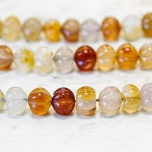 Shop Carnelian Rondelle Beads! M/ Natural Carnelian 10mm/ 12mm Corrugated Rondelle beads Approx. 15.5 inches long | Natural genuine rondelle Carnelian beads for beading and jewelry making.  #jewelry #beads #beadedjewelry #diyjewelry #jewelrymaking #beadstore #beading #affiliate #ad
