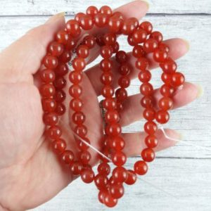 Shop Carnelian Round Beads! Carnelian Gemstone Beads, Reiki Infused Crystal Beads, 8mm Round Beads, Carnelian Beads | Natural genuine round Carnelian beads for beading and jewelry making.  #jewelry #beads #beadedjewelry #diyjewelry #jewelrymaking #beadstore #beading #affiliate #ad