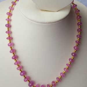 Shop Pink Sapphire Necklaces! Genuine Pink Sapphire Necklace ~~~ Smooth Rondelle ~~ Gold Plated Balls ~~~ 230 Carats ~~ 1 Strand ~~8-14 MM~~~ Natural Gemstone   Natural genuine Pink Sapphire necklaces. Buy crystal jewelry, handmade handcrafted artisan jewelry for women.  Unique handmade gift ideas. #jewelry #beadednecklaces #beadedjewelry #gift #shopping #handmadejewelry #fashion #style #product #necklaces #affiliate #ad