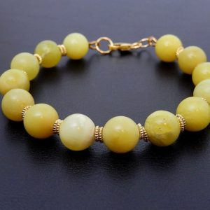 Shop Serpentine Bracelets! Gold Serpentine Bracelet, Yellow Jade, Stone Beaded Jewelry | Natural genuine Serpentine bracelets. Buy crystal jewelry, handmade handcrafted artisan jewelry for women.  Unique handmade gift ideas. #jewelry #beadedbracelets #beadedjewelry #gift #shopping #handmadejewelry #fashion #style #product #bracelets #affiliate #ad