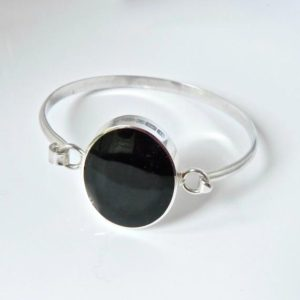 Shop Jet Bracelets! Whitby Jet Bangle- Handmade – Sterling Silver – Tension Bangle set with Oval Whitby Jet Stone – Silver Bangle | Natural genuine Jet bracelets. Buy crystal jewelry, handmade handcrafted artisan jewelry for women.  Unique handmade gift ideas. #jewelry #beadedbracelets #beadedjewelry #gift #shopping #handmadejewelry #fashion #style #product #bracelets #affiliate #ad