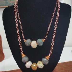 Shop Ocean Jasper Necklaces! Long Necklace with Green, Brown, & Cream Faceted Ocean Jasper Rondelles, Olive Wood Disks from Afghanistan, and Copper Chain and Findings | Natural genuine Ocean Jasper necklaces. Buy crystal jewelry, handmade handcrafted artisan jewelry for women.  Unique handmade gift ideas. #jewelry #beadednecklaces #beadedjewelry #gift #shopping #handmadejewelry #fashion #style #product #necklaces #affiliate #ad