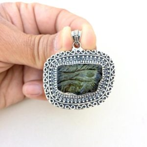 Shop Moldavite Necklaces! eye of horus necklace, eye of horus pendant, carve moldavite eye of horus, silver necklace, protection necklace, egyptian necklace | Natural genuine Moldavite necklaces. Buy crystal jewelry, handmade handcrafted artisan jewelry for women.  Unique handmade gift ideas. #jewelry #beadednecklaces #beadedjewelry #gift #shopping #handmadejewelry #fashion #style #product #necklaces #affiliate #ad