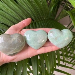 Shop Moonstone Shapes! Garnierite Heart, Green Moonstone Heart, Garnierite Crystal, Puffy Garnierite Hearts, High Quality Green Moonstone | Natural genuine stones & crystals in various shapes & sizes. Buy raw cut, tumbled, or polished gemstones for making jewelry or crystal healing energy vibration raising reiki stones. #crystals #gemstones #crystalhealing #crystalsandgemstones #energyhealing #affiliate #ad