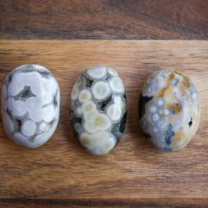 Shop Ocean Jasper Shapes! Ocean Jasper Palms | Orbicular Jasper Crystal Palmstone | Natural genuine stones & crystals in various shapes & sizes. Buy raw cut, tumbled, or polished gemstones for making jewelry or crystal healing energy vibration raising reiki stones. #crystals #gemstones #crystalhealing #crystalsandgemstones #energyhealing #affiliate #ad