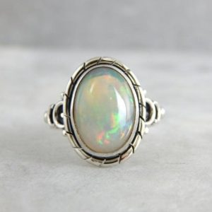 Shop Opal Rings! Glowing Colors And Polished Gold, Ethiopian Opal And Sterling Ring 5HTKT7-P | Natural genuine Opal rings, simple unique handcrafted gemstone rings. #rings #jewelry #shopping #gift #handmade #fashion #style #affiliate #ad