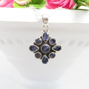 Shop Iolite Pendants! Ornate Iolite Pendant set in 925 Sterling Silver  on sturdy Silver Plated 18 inch Chain   Natural genuine Iolite pendants. Buy crystal jewelry, handmade handcrafted artisan jewelry for women.  Unique handmade gift ideas. #jewelry #beadedpendants #beadedjewelry #gift #shopping #handmadejewelry #fashion #style #product #pendants #affiliate #ad
