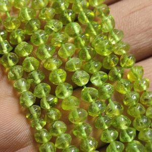 Shop Peridot Bead Shapes! Beautiful Natural Peridot Smooth Button Shape Gemstone Beads Strand | Peridot Smooth Button Beads Strand | 4-5MM Peridot Smooth Beads Strand | Natural genuine other-shape Peridot beads for beading and jewelry making.  #jewelry #beads #beadedjewelry #diyjewelry #jewelrymaking #beadstore #beading #affiliate #ad
