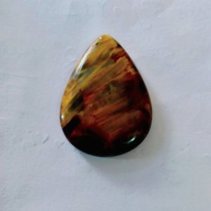 Shop Pietersite Stones & Crystals! Natural Pietersite 20x27x4 mm pear shape cabochon gemstone | Natural genuine stones & crystals in various shapes & sizes. Buy raw cut, tumbled, or polished gemstones for making jewelry or crystal healing energy vibration raising reiki stones. #crystals #gemstones #crystalhealing #crystalsandgemstones #energyhealing #affiliate #ad