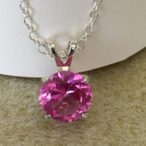 Shop Pink Sapphire Necklaces! Pink Sapphire Necklace, Sterling Silver Chain with Sterling Silver Lobster Claw Closure. 9 millimeter Round. 2.75 carat.   Free Shipping   Natural genuine Pink Sapphire necklaces. Buy crystal jewelry, handmade handcrafted artisan jewelry for women.  Unique handmade gift ideas. #jewelry #beadednecklaces #beadedjewelry #gift #shopping #handmadejewelry #fashion #style #product #necklaces #affiliate #ad
