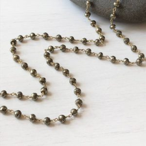Shop Pyrite Necklaces! Pyrite Necklace, Long Pyrite Beaded Necklace, Gold Pyrite Wrap Necklace, Delicate Layering Necklace, Rosary Style Necklace, Gift for her | Natural genuine Pyrite necklaces. Buy crystal jewelry, handmade handcrafted artisan jewelry for women.  Unique handmade gift ideas. #jewelry #beadednecklaces #beadedjewelry #gift #shopping #handmadejewelry #fashion #style #product #necklaces #affiliate #ad