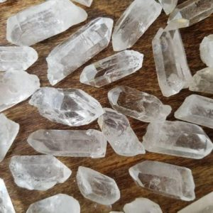 Shop Quartz Stones & Crystals! Small Grade A Clear Quartz Point, Natural Quartz Point, Quartz Crystal | Natural genuine stones & crystals in various shapes & sizes. Buy raw cut, tumbled, or polished gemstones for making jewelry or crystal healing energy vibration raising reiki stones. #crystals #gemstones #crystalhealing #crystalsandgemstones #energyhealing #affiliate #ad
