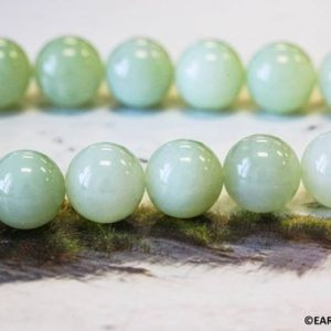 """Shop Serpentine Round Beads! L / New Jade 16mm Smooth Round Beads 15.5"""" Strand Natural Light Green Serpentine Gemstone Beads For Jewelry Designs   Natural genuine round Serpentine beads for beading and jewelry making.  #jewelry #beads #beadedjewelry #diyjewelry #jewelrymaking #beadstore #beading #affiliate #ad"""