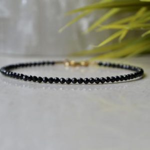 Shop Spinel Bracelets! Black Spinel bracelet, tiny black bead bracelets, bracelet femme, Ultra Thin Genuine Spinel crystal bracelet, root chakra bracelet bracelet | Natural genuine Spinel bracelets. Buy crystal jewelry, handmade handcrafted artisan jewelry for women.  Unique handmade gift ideas. #jewelry #beadedbracelets #beadedjewelry #gift #shopping #handmadejewelry #fashion #style #product #bracelets #affiliate #ad
