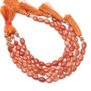 Shop Sunstone Chip & Nugget Beads! AAA+ Sunstone Gemstone 7x9mm-8x11mm Smooth Oval Nugget Beads | Natural Sunstone Fiery Tumbled Semi Precious Gemstone Beads | 8inch Strand | Natural genuine chip Sunstone beads for beading and jewelry making.  #jewelry #beads #beadedjewelry #diyjewelry #jewelrymaking #beadstore #beading #affiliate #ad