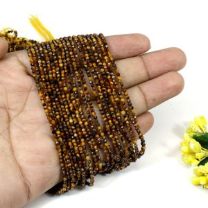 Shop Tiger Eye Rondelle Beads! Tiger eye 2 MM small rondelle faceted 13 Inch gemstone wholesale beads strands for making necklace jewelry- handmade beads strands | Natural genuine rondelle Tiger Eye beads for beading and jewelry making.  #jewelry #beads #beadedjewelry #diyjewelry #jewelrymaking #beadstore #beading #affiliate #ad