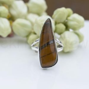 Shop Tiger Eye Rings! Tiger Eye Gemstone Ring, Sterling Silver Ring, Fancy Shape Stone Ring, Statement Ring, Cabochon Gemstone, Split Band Ring, Natural Gemstone   Natural genuine Tiger Eye rings, simple unique handcrafted gemstone rings. #rings #jewelry #shopping #gift #handmade #fashion #style #affiliate #ad