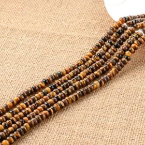 Shop Tiger Eye Rondelle Beads! Tiger eyes – rondelle beads – full strand – 4mmx6mm Yellow tiger eyes | Natural genuine rondelle Tiger Eye beads for beading and jewelry making.  #jewelry #beads #beadedjewelry #diyjewelry #jewelrymaking #beadstore #beading #affiliate #ad