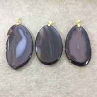 Natural Black / gray Agate Freeform Shaped Pendant With Gold Plated Bail – Measuring – 65-80mm Long, Approx. – Sold Individually, Random | Natural genuine Gemstone jewelry. Buy crystal jewelry, handmade handcrafted artisan jewelry for women.  Unique handmade gift ideas. #jewelry #beadedjewelry #beadedjewelry #gift #shopping #handmadejewelry #fashion #style #product #jewelry #affiliate #ad