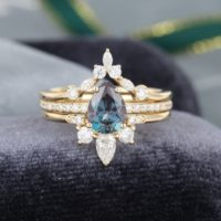 3pcs Pear Shaped Yellow Gold Alexandrite Engagement Ring Set Vintage Unique Curved Marquise Cut Moissanite Ring For Women | Natural genuine Gemstone jewelry. Buy handcrafted artisan wedding jewelry.  Unique handmade bridal jewelry gift ideas. #jewelry #beadedjewelry #gift #crystaljewelry #shopping #handmadejewelry #wedding #bridal #jewelry #affiliate #ad