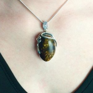 Shop Amber Pendants! Vine-Wrapped Golden Amber Pendant // Amber Jewelry // Sterling Silver // Village Silversmith | Natural genuine Amber pendants. Buy crystal jewelry, handmade handcrafted artisan jewelry for women.  Unique handmade gift ideas. #jewelry #beadedpendants #beadedjewelry #gift #shopping #handmadejewelry #fashion #style #product #pendants #affiliate #ad