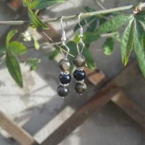 Shop Golden Obsidian Earrings! Black golden and obsidian pendant earrings | Natural genuine Golden Obsidian earrings. Buy crystal jewelry, handmade handcrafted artisan jewelry for women.  Unique handmade gift ideas. #jewelry #beadedearrings #beadedjewelry #gift #shopping #handmadejewelry #fashion #style #product #earrings #affiliate #ad