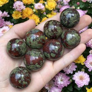 Shop Bloodstone Stones & Crystals! Rare Bastite Sphere – Dragon Blood Stone – Dragon Stone – Crystal Sphere – Crystal Ball – Home Decor – Sacred Space | Natural genuine stones & crystals in various shapes & sizes. Buy raw cut, tumbled, or polished gemstones for making jewelry or crystal healing energy vibration raising reiki stones. #crystals #gemstones #crystalhealing #crystalsandgemstones #energyhealing #affiliate #ad