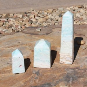 Shop Calcite Points & Wands! Caribbean Teal Calcite Tower A-C | Natural genuine stones & crystals in various shapes & sizes. Buy raw cut, tumbled, or polished gemstones for making jewelry or crystal healing energy vibration raising reiki stones. #crystals #gemstones #crystalhealing #crystalsandgemstones #energyhealing #affiliate #ad