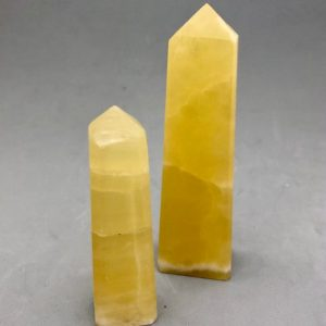 Shop Calcite Points & Wands! Lemon Yellow Calcite Obelisk | Natural genuine stones & crystals in various shapes & sizes. Buy raw cut, tumbled, or polished gemstones for making jewelry or crystal healing energy vibration raising reiki stones. #crystals #gemstones #crystalhealing #crystalsandgemstones #energyhealing #affiliate #ad