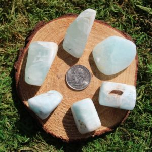 Shop Tumbled Calcite Crystals & Pocket Stones! Caribbean Teal Calcite Tumbled Stones A-K | Natural genuine stones & crystals in various shapes & sizes. Buy raw cut, tumbled, or polished gemstones for making jewelry or crystal healing energy vibration raising reiki stones. #crystals #gemstones #crystalhealing #crystalsandgemstones #energyhealing #affiliate #ad